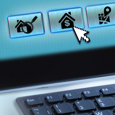 a laptop cursor pointing at a house button