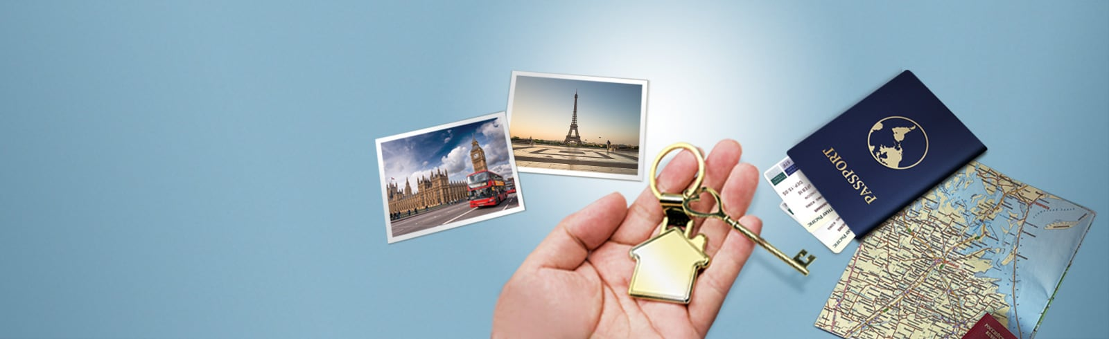 photos, passport, map, and a hand holding a key with a house keychain