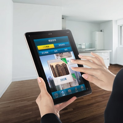 Using a tablet to search through SC Home for mortgage details