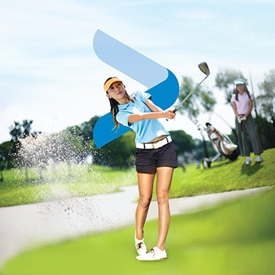 a lady playing golf in a golf course