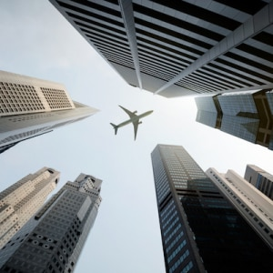 Px photo id tall city buildings and a plane flying overhead