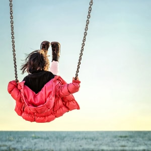 Px photo id little girl on the swing watching the sunset over the sea