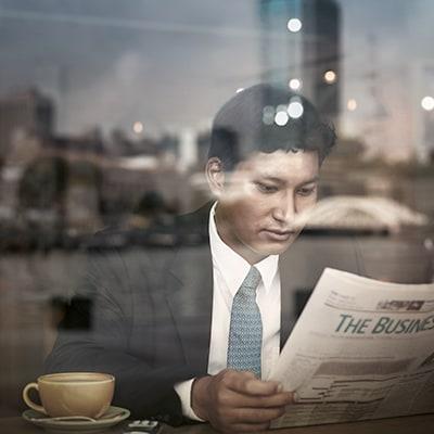 Man reading paper x