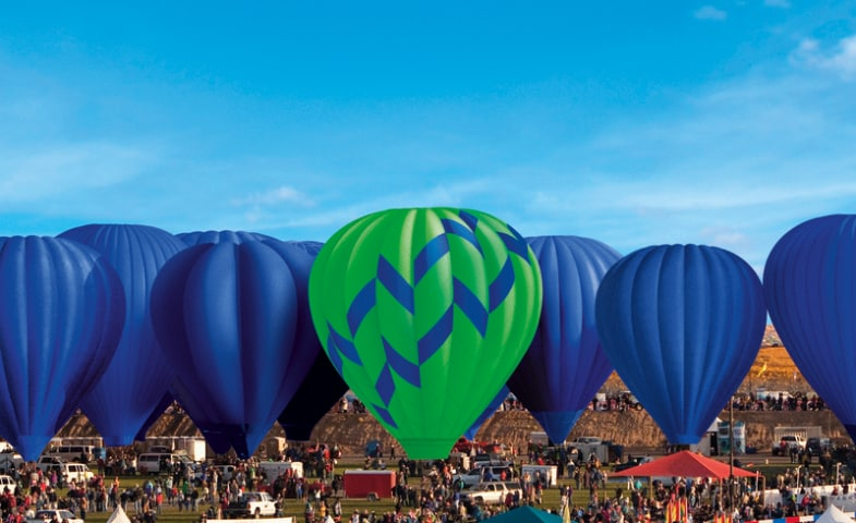 Hot air balloon floating above others at festival albuquerque new mexico united states