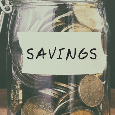 Coins in jar with text savings