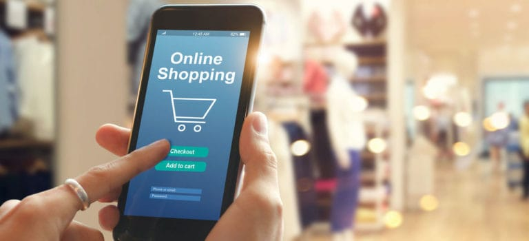 Smart phone online shopping in woman hand network connection on mobile screen payments online shopping mall department store background