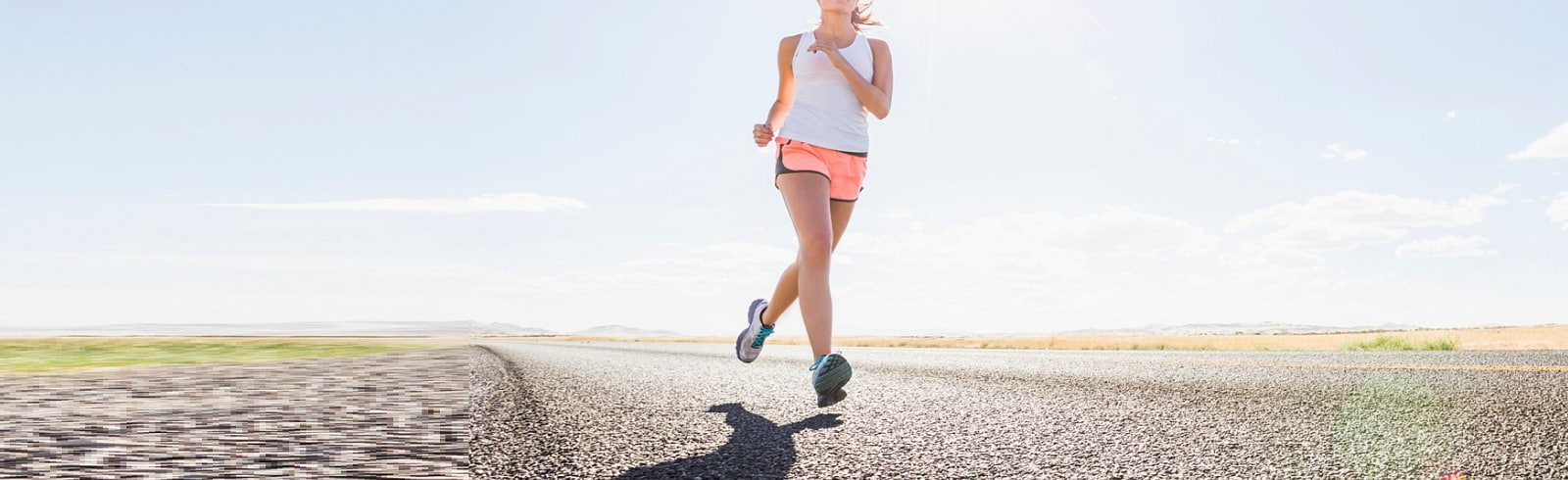 Caucasian woman running on remote road