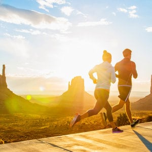 Stock photo caucasian couple running in monument valley utah united states