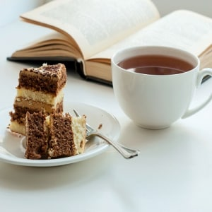 Px photo id cup of tea cake and some books to read lying on the table